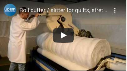 Roll cutter or slitter for quilts
