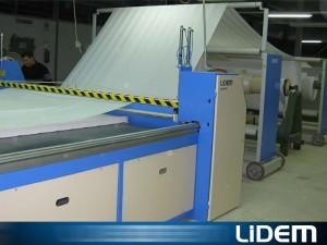 Máquina extendedora cortadora para rollos de gran diámetro